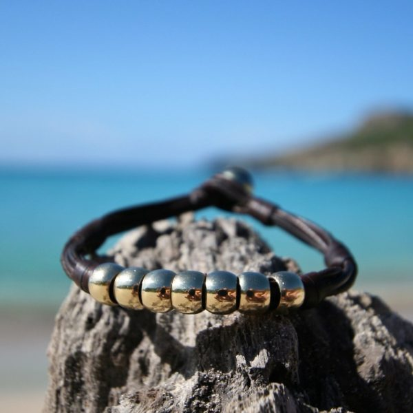 Leather bracelet featuring 7 gold pearls & Tahitian black pearl, beach jewelry, bohochic, St barth island, handmade leather chic jewelry.